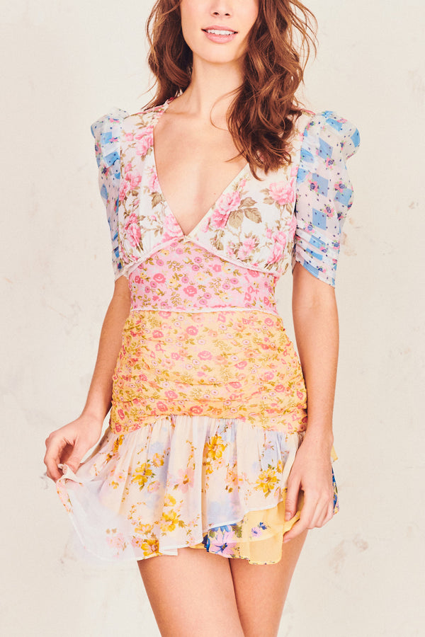 Multi-colored floral print mini dress with puffed sleeve, ruched skirt, fitted waist and V-neck detail