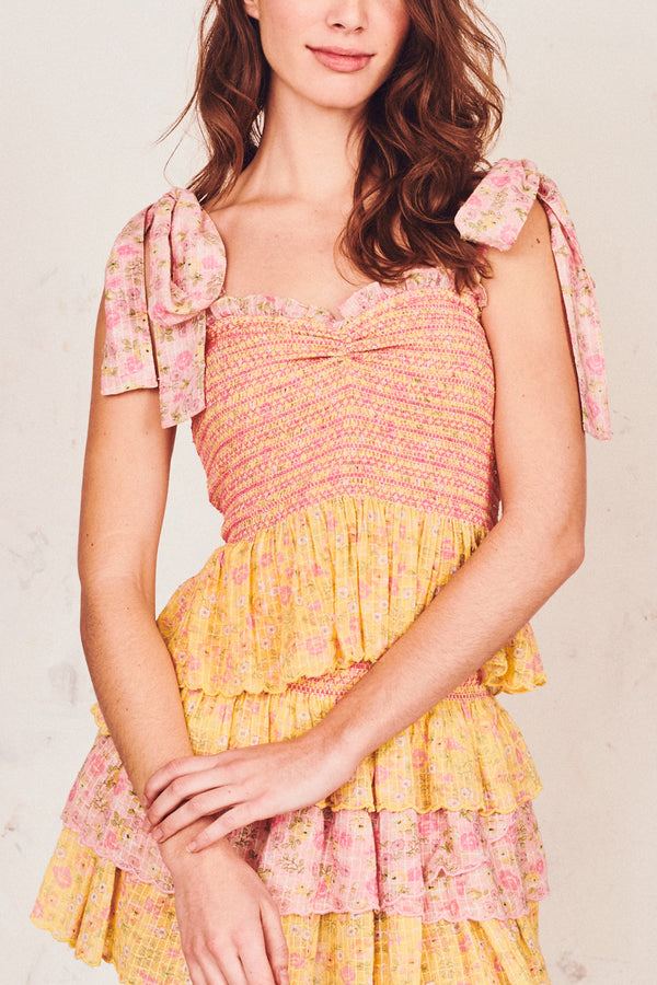 Pink and yellow floral print shirred peplum tank with sweetheart neckline and bows at the shoulder
