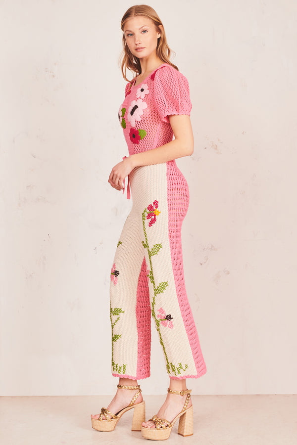 White hand crochet pants with floral print and plant stem design