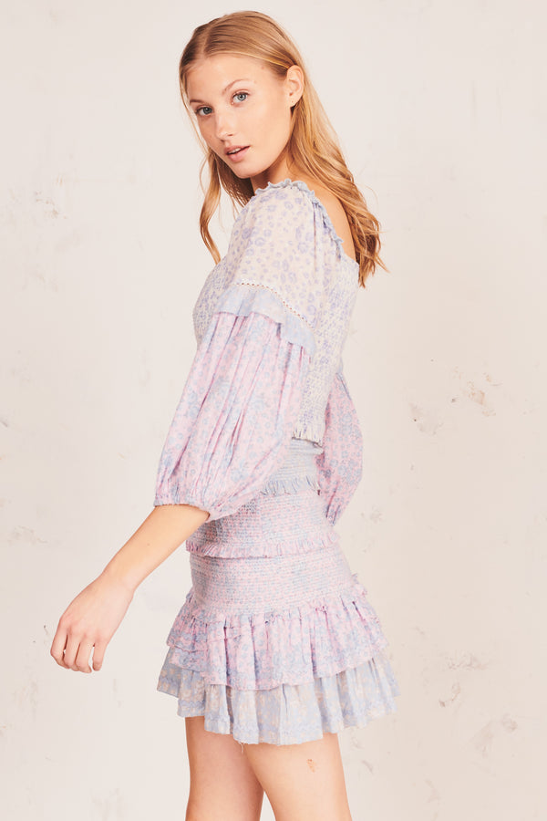 Blue and pink floral print mini dress with shirred bodice and puffed long sleeves and tiered ruffle skirt