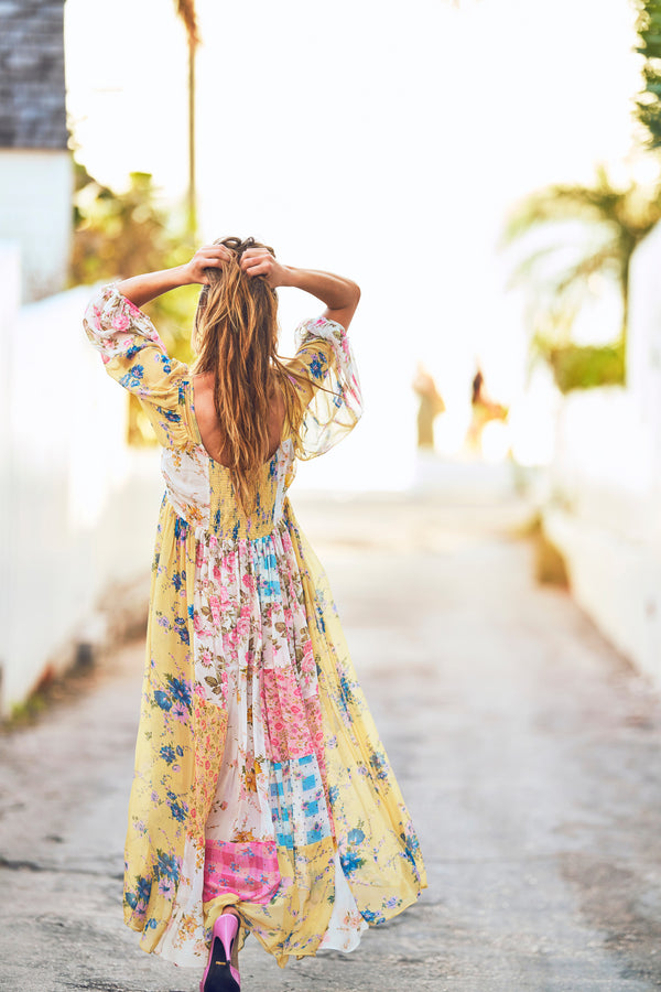 Multi-print floral print maxi dress with fitted waist and white embroidery detail and deep V-neck and puffed long sleeves