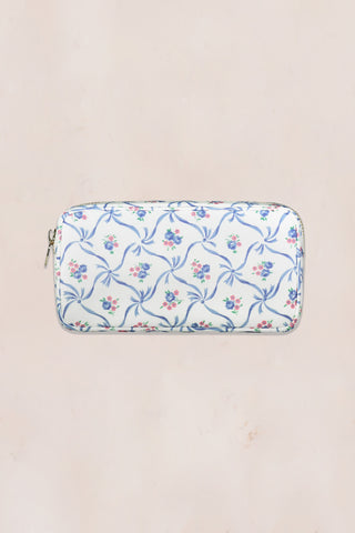 Blue and white floral print small pouch with gold zipper detail