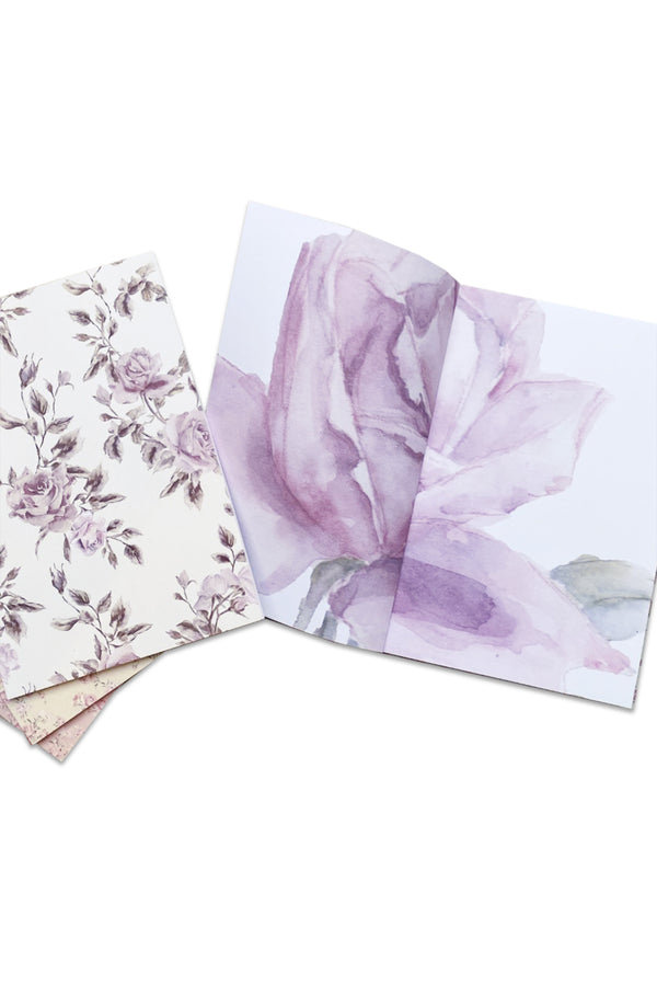 Set of 4 floral print notebooks in purple, pink, white and green
