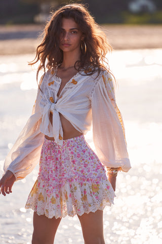 Pink, white and yellow floral print mini skirt with white embroidery detailing and elastic waist