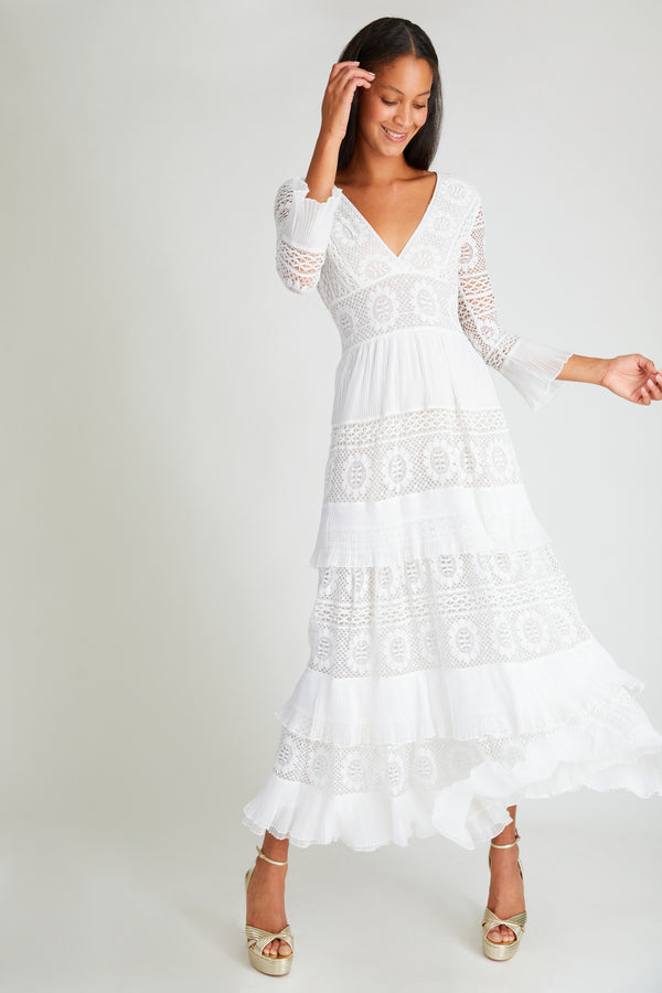 Fitted white long-sleeves maxi dress with embroidery detail and tiered ruffle skirt