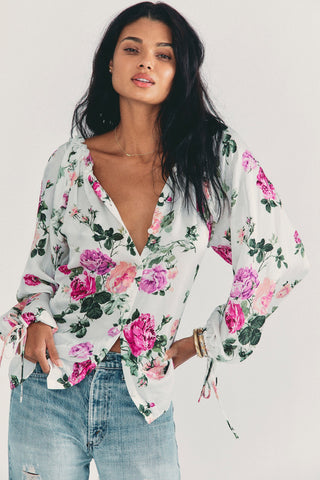 White long sleeve blouse with pink floral print