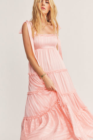 Pink maxi dress with ruffle detail and slit on the side with tie shoulder straps