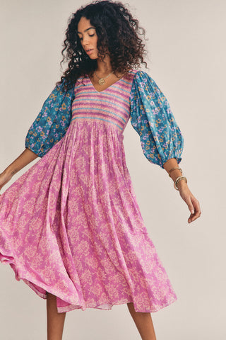Pink multi-colored floral print maxi dress with blue colored long sleeves and smocked v neck top