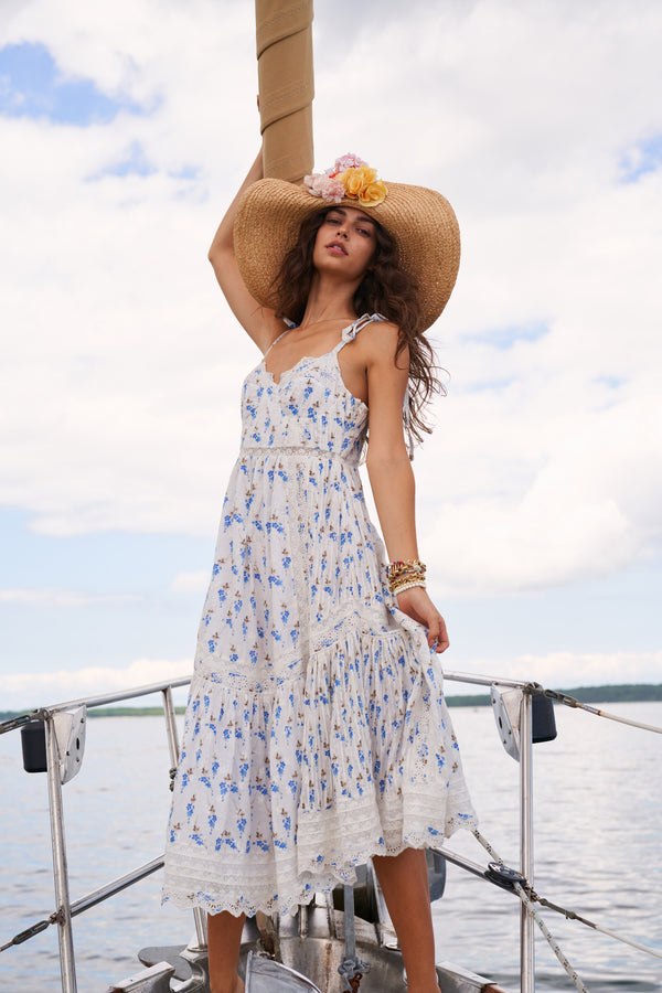White and blue floral printed maxi dress with embroidery detail and bows at the shoulder