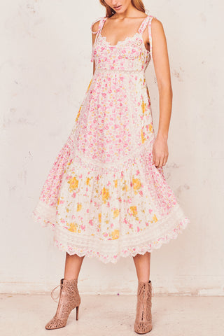 Pink and white floral printed maxi dress with embroidery detail and bows at the shoulder