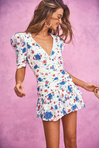Blue, red and white floral print mini dress with puffed sleeve, ruched skirt, and V-neck detail