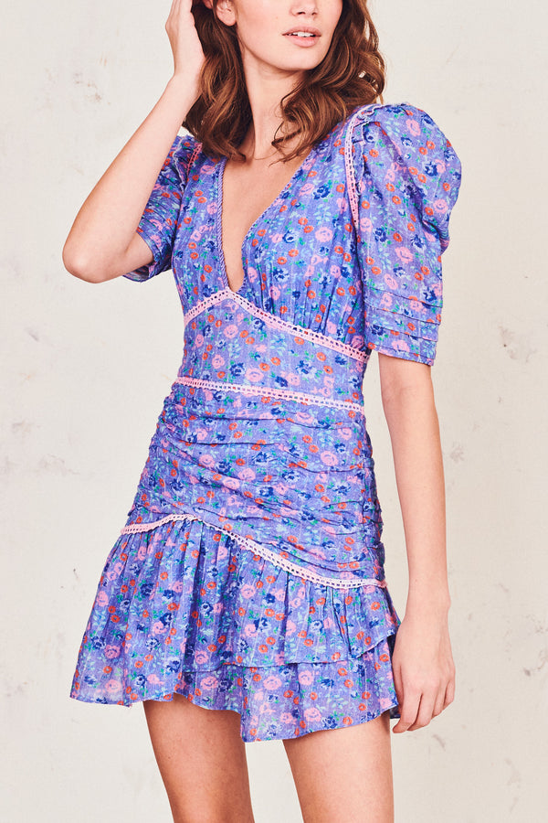 Blue floral print mini dress with puffed sleeve, ruched skirt, fitted waist and V-neck detail