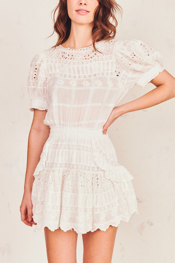 White print mini dress with puffed short sleeve and white embroidery detail