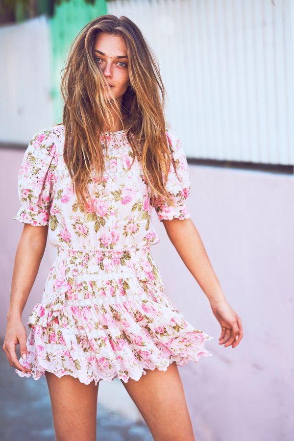 Pink floral print mini dress with puffed short sleeve and white embroidery detail