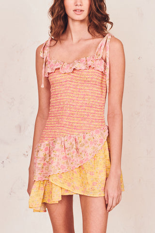 Pink and yellow floral print mini dress with smocked body detail and attachable bows at the shoulders