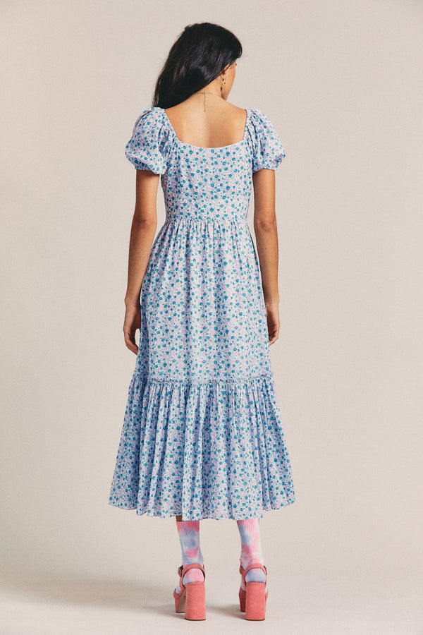 Blue floral print v neck maxi dress with short puffed sleeves and fitted waist