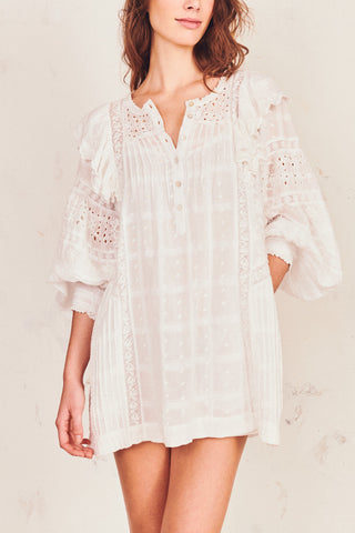 White embroidered mini dress with puffed mid sleeve and ruffle shoulder detail