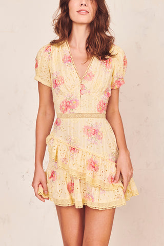 Yellow and pink floral mini dress with tiered ruffled skirt and puffed short sleeves with deep V-neck and embroidery detail