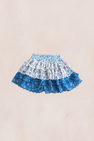 Blue and white floral print mini skirt with shirred elastic waist and tiered ruffle bottom