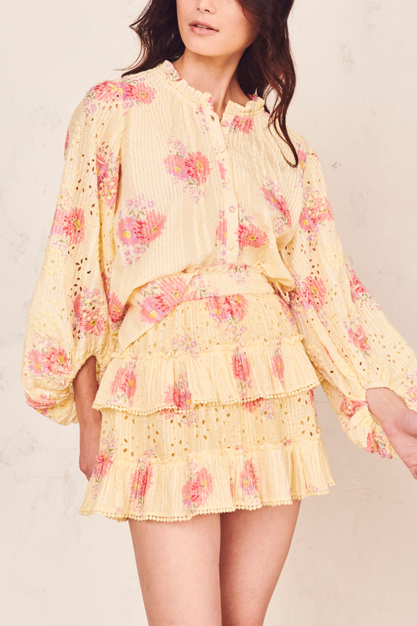 Pink and yellow floral print mini skirt with tiered ruffle skirt and shirred elastic waist