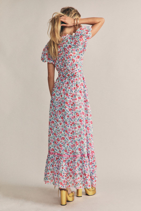 Multi colored pink floral print maxi dress with short puffed sleeves and tiered skirt