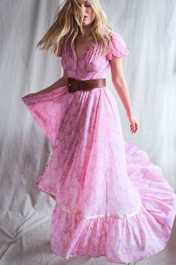 Pink floral print button down maxi dress with short puffed sleeves and tiered skirt