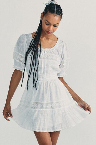 White short sleeved mini dress with lace detailing and elastic waist