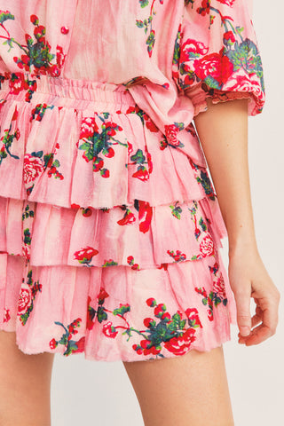 Pink and red floral mini skirt with tiered ruffle skirt detail and elastic waist
