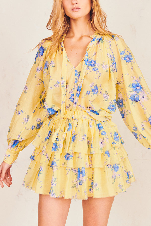 Yellow and blue floral print mini skirt with elastic waist and tiered ruffle skirt