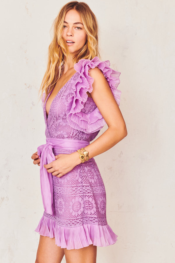 Purple lace detail mini dress with flutter ruffle trim sleeves, front tie bow, and deep V-neck
