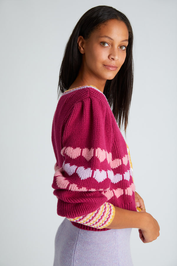Maroon colored cropped cardigan with heart detailing on sleeves