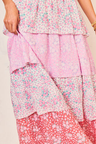 Pink and white floral maxi dress with tiered ruffle skirt, shirred bodice and bow at shoulders