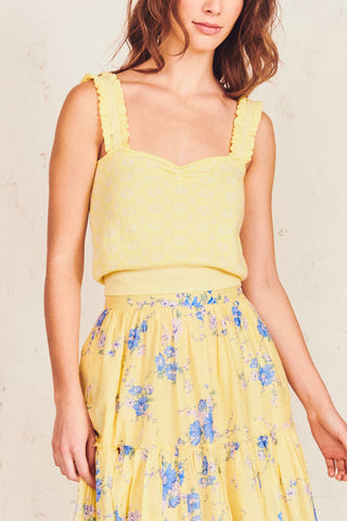 Yellow floral print tank top with ruffled straps and fitted waist