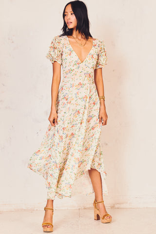 Fitted white and pink floral print maxi dress with deep V-neck detail and short puffed sleeves