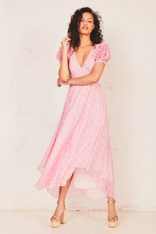 Fitted pink floral print maxi dress with ruffle detail short sleeves and deep V-neckline