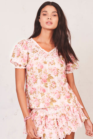 Pink floral print top with puffed short sleeve and V-neck embroidery detail