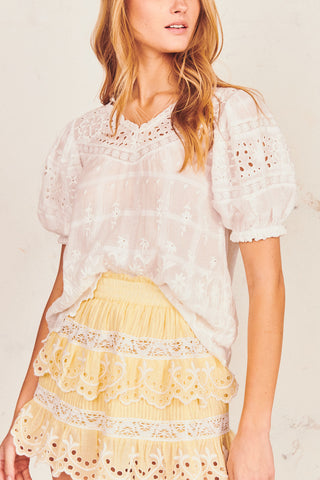 White floral top with puffed short sleeve and V-neck embroidery detail
