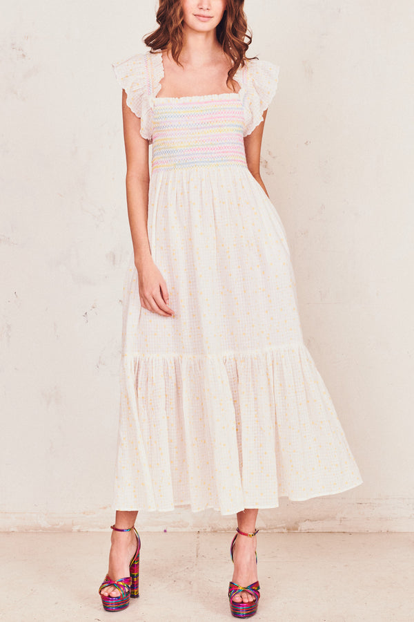White and multi-colored maxi dress with ruffle flutter sleeves and shirred bodice and flowy skirt