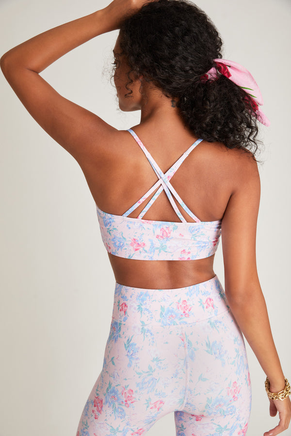 Pink and blue floral print workout halter top with strappy criss cross back