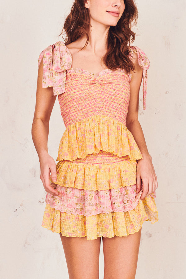 Pink and yellow floral print mini skirt with tiered ruffle skirt and shirred waist