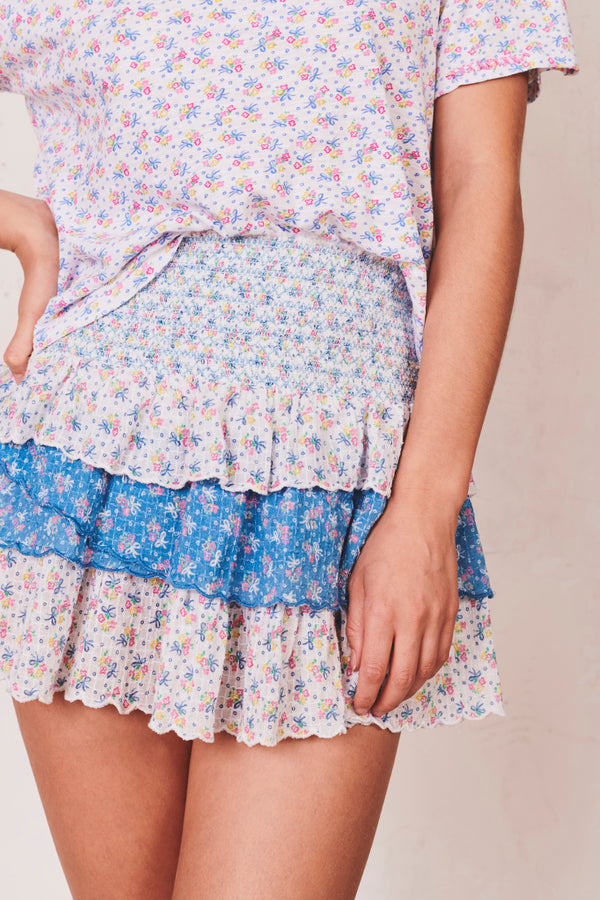 Blue and white floral print mini skirt with tiered ruffle skirt and shirred waist