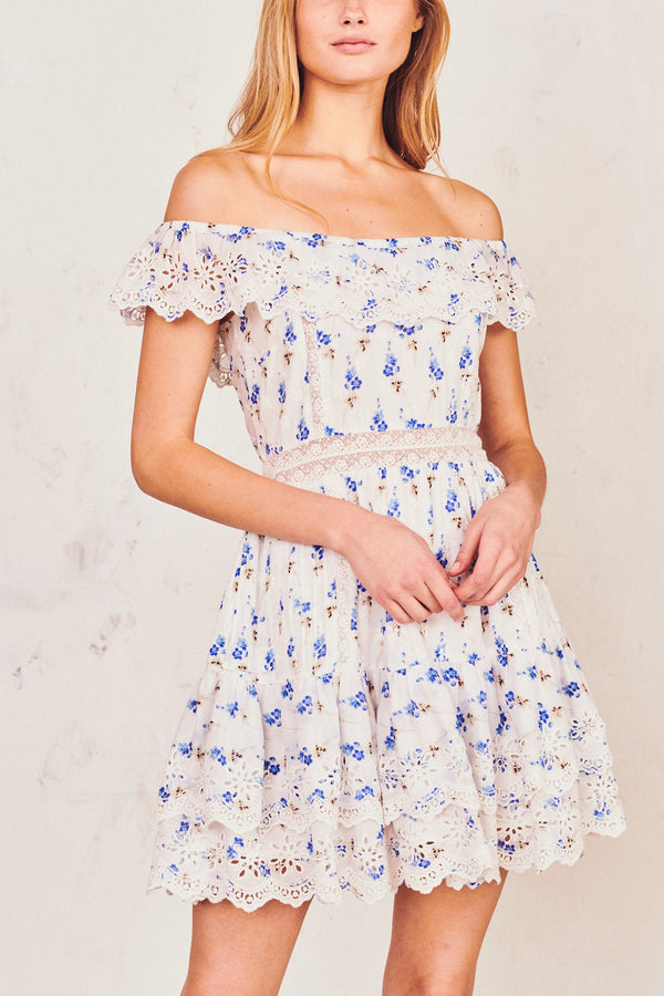Blue and white off shoulder mini dress with white embroidery detail and tiered ruffle skirt