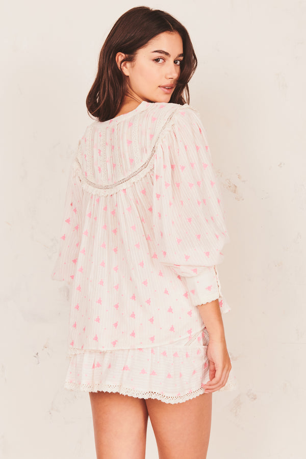 Pink and white floral top with white embroidery and long puffed sleeves