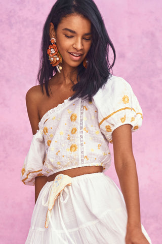 White off the shoulder top with yellow embroidery detail and puffed short sleeve