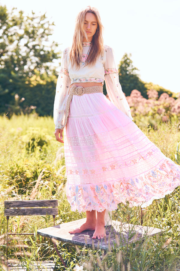 Pink embroidered maxi skirt with elastic waist and floral tiered bottom