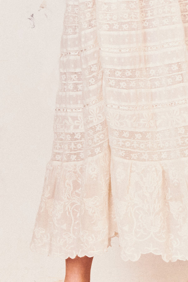 White embroidered maxi skirt with elastic waist and tiered bottom