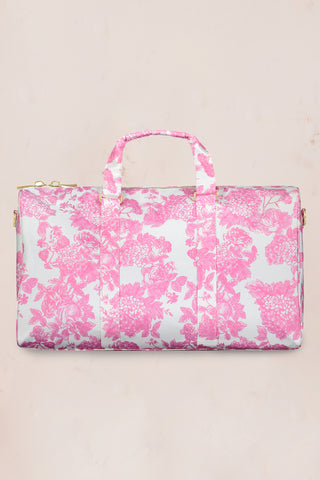 Pink and white floral duffle bag with gold zipper detail