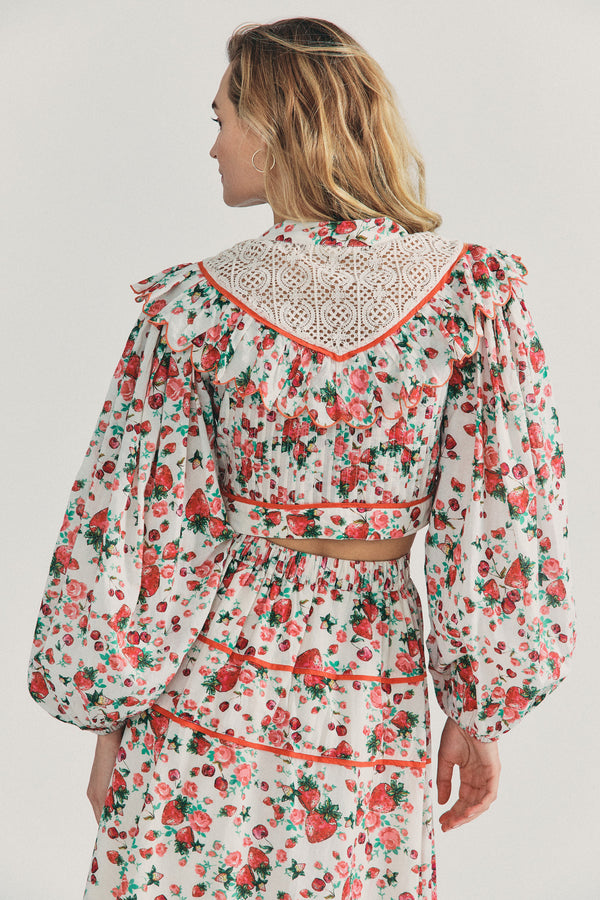 Strawberry print crop top with puffed long sleeve and lace collar detail with buttons going down