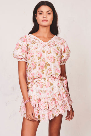 Pink floral print ruffled tier mini skirt with white embroidery detail and elastic waist