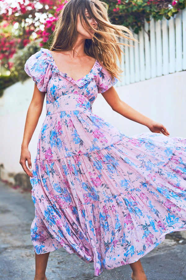 Fitted pink and blue floral print maxi dress with tiered skirt and puffed short sleeve